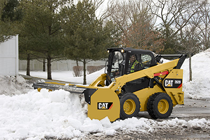 Snow removal in Western Canada using a Cat Skid Steer