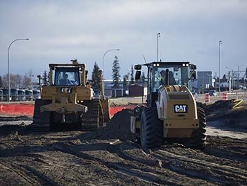 Cat Compactor and Dozer