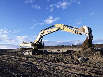 Cat Excavator digging earth